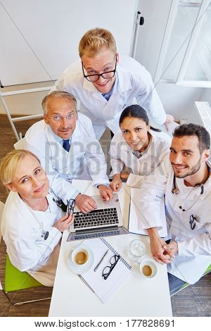 Successful group of doctors as a team in meeting at medical clinic