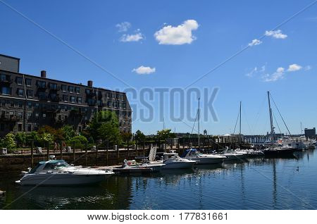 Boats docked in Boston harbor during the summer months.