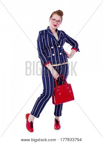 Stylish middle-aged lady in impressive checkered suit isolated on white background