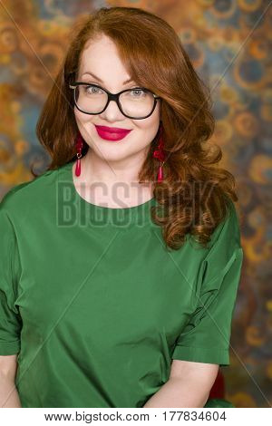 Close up portrait of red hair woman wearing a glasses