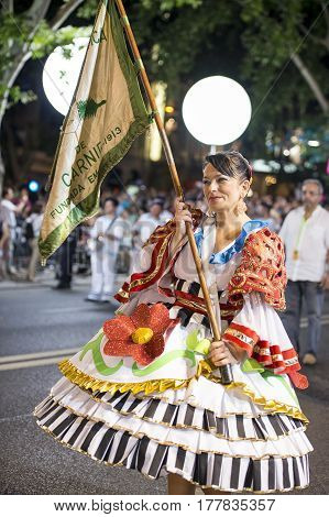 Lisbon Portugal - June 12 2014: Woman at the parade of popular marches (Marchas Populares) during the Saint Anthony Feast at the Liberdade Avenue (Avenida da Liberdade) in Lisbon Portugal