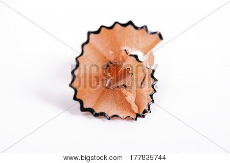 Pencil shaving is isolated on a white background