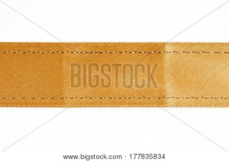 Christmas decor. Gold ribbon isolated on a white background