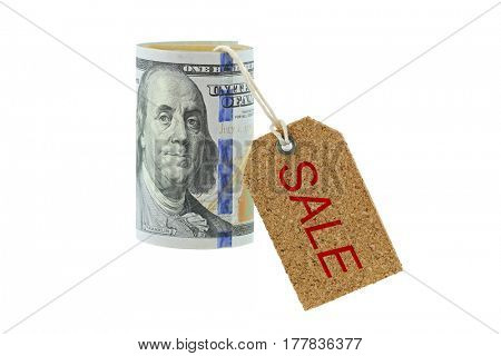 Rolled new United stated 100 dollar banknote, money roll with cork SALE tag hanging, isolated on white background