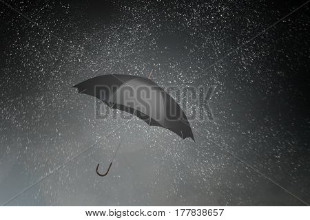 Black umbrella in sky . Mixed media