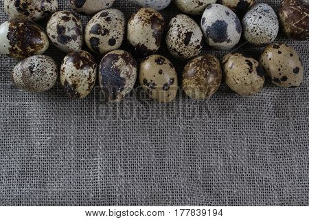 Textured spring background with small quail eggs. Eco products