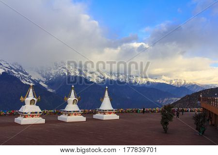 Scenery of Meili snow mountain and row of Tibetan stupas this is viewpoint from Feilai temple at Deqing Yunnan China.