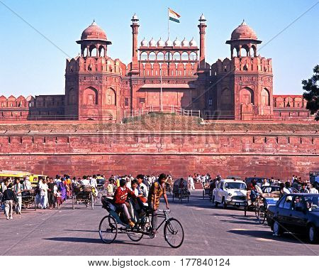 DELHI, INDIA - NOVEMBER 20, 1993 - View of the Red Fort with local people in the foreground Delhi Delhi Union Territory India, November 20, 1993.