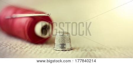 Hobby diy concept - old needle thread and thimble