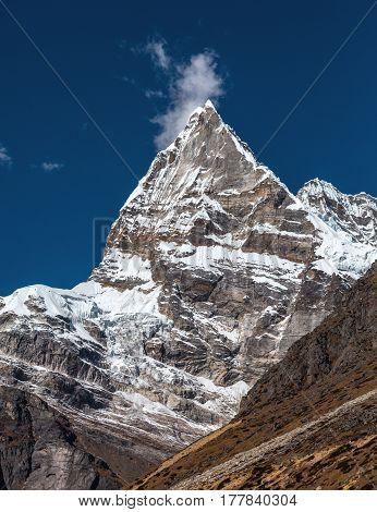 Sharp pointed Mountain Peak in Nepal Himalaya. Unusual pyramidal geological Formation