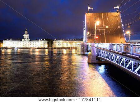 Palace Bridge Neva River and University Embankment at night in St.Petersburg Russia.