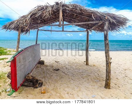 A Hut sits on the sandy white beach