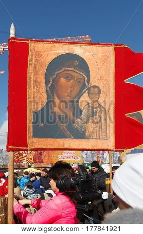 VOLGOGRAD RUSSIA - February 26 2017: A red flag with the image of Christian symbols sacred on the city street