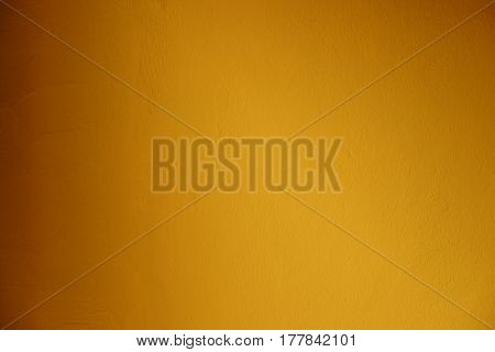 Closeup on yellow cement background yellow cement layout design for warm colorful background.