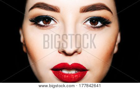 pretty woman or cute sexy girl with red lips bright eyelashes eye makeup on adorable face with open mouth and soft skin