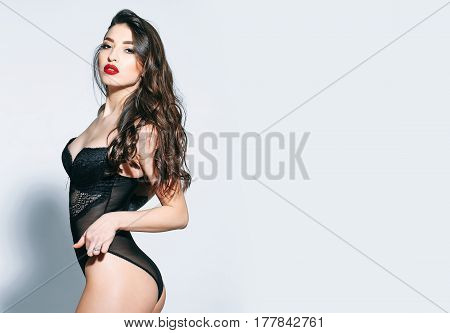 Sexy Woman With Red Lips, Long Hair In Black Bodysuit