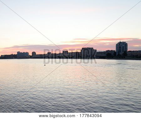 Silhouette of the Sverdlovskaya embankment before dawn in St.Petersburg Russia.