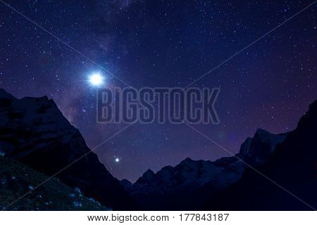 Night View of Mountain Ridge illuminated by shining Moon and Stars