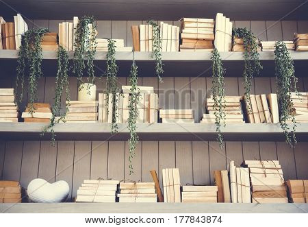 Lots of book on the wooden shelf in library
