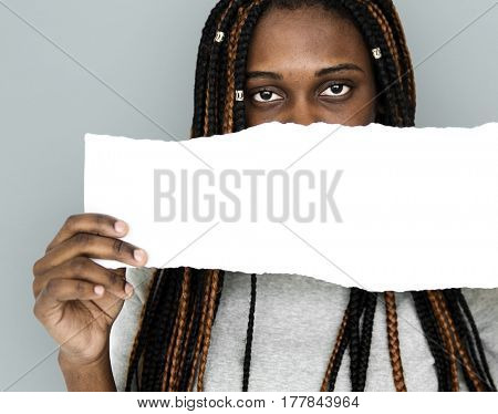 African descent girl is holding a blank paper
