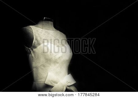 Mannequin with white basic wedding dress. No people