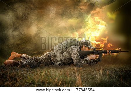Soldier taking aim from rifle on battlefield