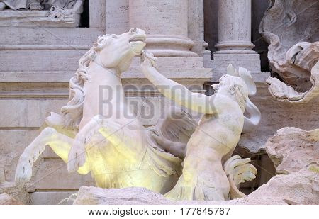 ROME, ITALY - SEPTEMBER 01: Triton and Winged Horse on the Trevi Fountain in Rome. Fontana di Trevi is one of the most famous landmark in Rome, Italy on September 01,2016.