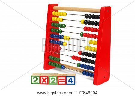Educational abacus and wooden blocks isolated on white background
