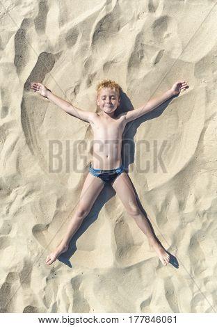 Little Boy Plays In Angel