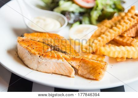 Grilled salmon steak and grilled potatoes .