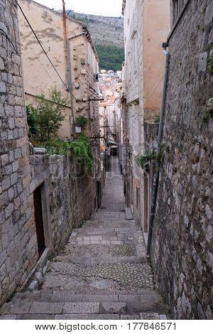 DUBROVNIK, CROATIA - DECEMBER 01: Narrow street inside Dubrovnik old town, Croatia on December 01, 2015.