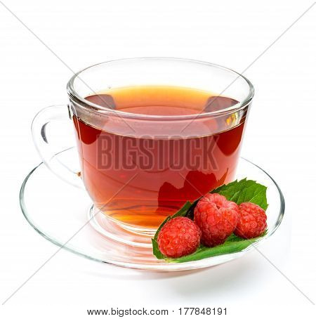 Transparent cup of tea with raspberry isolated on white background. Berries and leaves
