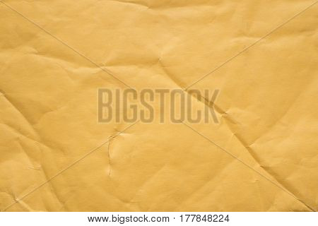 highly detailed crumpled yellow packing paper background