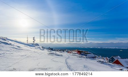 Arctic Sun Halo Shining Over Houses At The Fjord Of Nuuk City, Greenland