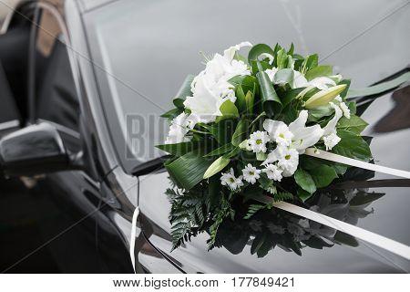Car decoration. Colorful bridal bouquet, wedding day accessories