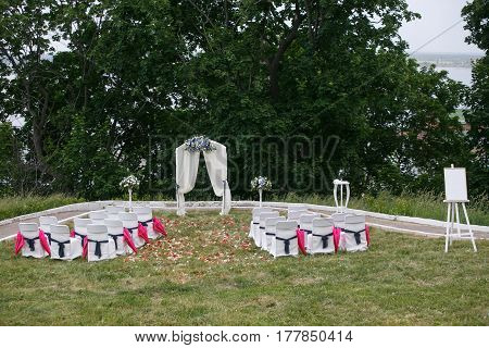 Wedding registration beautiful in nature. White chairs for visiting registration. Pink tent with white flowers for the exit registration. White and pink peonies with roses. Wedding details