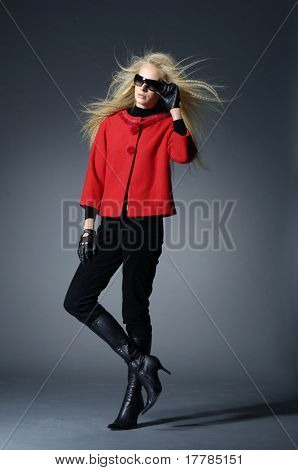 Young fashion model on light background