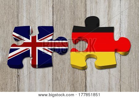 Relationship between the Britain and Germany Two puzzle pieces with the flags of Britain and Germany on weathered wood 3D Illustration