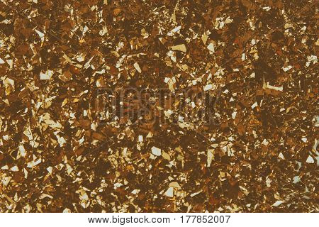golden glass granules background texture vintage toned