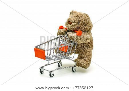 Isolated Teddy Bear Toy Is Pushing The Trolley Cart On White Background