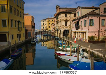 CHIOGGIA, ITALY - MARCH 19, 2017: Colorful houses and boats along canal Vena in the romantic center of Chioggia, Veneto, Italy