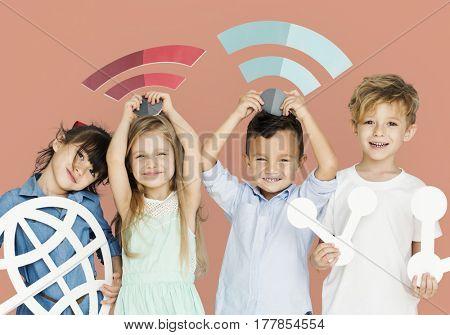 Little Children Holding Technology Symbols