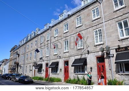 QUEBEC CITY, CANADA - SEP 10, 2011: Colorful Stone Houses on Rue d'Auteuil in Old Quebec City, Quebec, Canada. Historic District of Quebec City is UNESCO World Heritage Site since 1985.