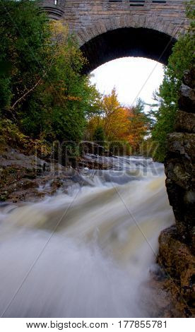 River Flowing Under Historic Arched Stone Bridge Acadia National Park