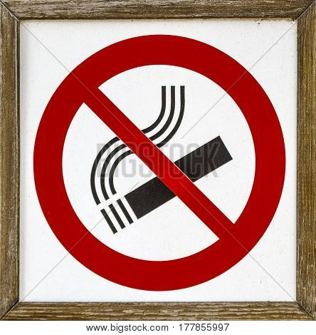 Close-up image of informative no smoking sign framed in wood