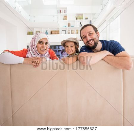 Man woman and child family at home