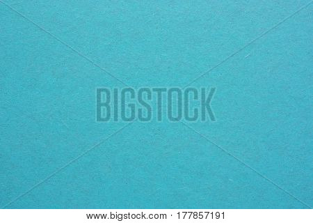 Blank sheet of paper or plywood in blue colours. Rough surface of background. Concept of recycling raw materials. Natural paper background texture for your design. Rustic, vintage style. Horizontal.
