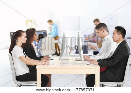 Young people working in modern office