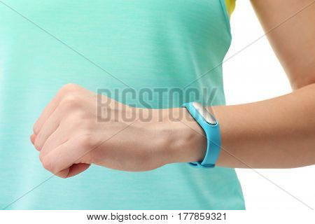 Closeup view of woman with fitness tracker on hand