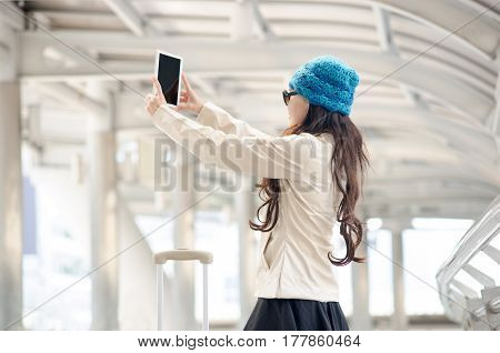 Young Woman Tourist Using Tablet Take Photo.
